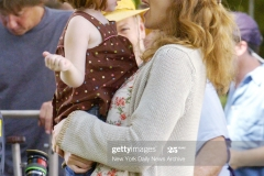 "UNITED STATES - AUGUST 22:  Kate Winslet holds Sadie Goldstein on the set of the movie, ""Little Children,"" which is being filmed in Walker Street Park on Staten Island. Winslet plays a young mother and Goldstein is her daughter in the film.  (Photo by Richard Corkery/NY Daily News Archive via Getty Images)"